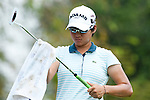 CHON BURI, THAILAND - FEBRUARY 18:  Yani Tseng of Taiwan cleans her club on the 3rd tee during day two of the LPGA Thailand at Siam Country Club on February 18, 2011 in Chon Buri, Thailand.  Photo by Victor Fraile / The Power of Sport Images