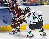 Benn Ferreiro, Taylor Chorney - The Boston College Eagles defeated the University of North Dakota Fighting Sioux 6-5 on Thursday, April 6, 2006, in the 2006 Frozen Four afternoon Semi-Final at the Bradley Center in Milwaukee, Wisconsin.