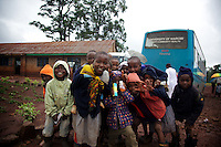 Young students hang around outside the schoolhouse in the midst of a one-day free clinic set up by University of Nairobi medical students. Githunguri, Kenya.