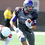 SIOUX FALLS, SD - SEPTEMBER 6: Nephi Garcia #3 from the University of Sioux Falls looks for room after beating Taylor Palade #48 from Minot State in the first quarter of their game Saturday afternoon at Bob Young Field in Sioux Falls.  (Photo by Dave Eggen/Inertia)