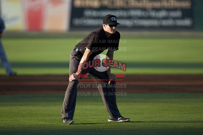 Umpire Nolan Early handles the calls on the bases during the South Atlantic League game between the Augusta GreenJackets and the Kannapolis Intimidators at Kannapolis Intimidators Stadium on June 21, 2019 in Kannapolis, North Carolina. The Intimidators defeated the GreenJackets 6-1. (Brian Westerholt/Four Seam Images)