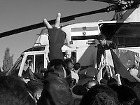 Senior Palestinian politician Mahmoud Abbas emerges from a helicopter carrying the body of Palestinian leader Yasser Arafat before the burial at the battered Muqata compound in the West Bank town of Ramallah on Friday November 12, 2004.