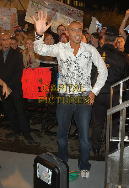 "RAY.final night ""Big Brother 4"".white shirt, denim jeans, trainers, suitcase, crowd, bald, full length, full-length, fans, waving, hand.sales@capitalpictures.com.www.capitalpictures.com.©Capital Pictures"