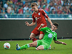 Mitchell Weiser of Bayern Munich and Vaclav Pilar of VfL Wolfsburg in action during a friendly match as part of the Audi Football Summit 2012 on July 26, 2012 at the Guangdong Olympic Sports Center in Guangzhou, China. Photo by Victor Fraile / The Power of Sport Images