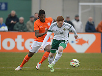 20150314 - GENDT , NETHERLANDS  : Northern-Irish Shane Lavery (10) pictured protecting the ball for Dutch defender Timothy Fosu-Mensah (left)  during the soccer match between Under 17 teams of  The Netherlands and Northern Ireland , on the second matchday in group 3 of the UEFA Elite Round Under 17 at De Bataven Stadion , Gendt , The Netherlands . Saturday  14 th March 2015 . PHOTO DAVID CATRY