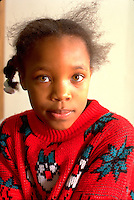 Thoughtful girl age 6 looking curious. Youth Express After School Study Program St Paul  Minnesota USA