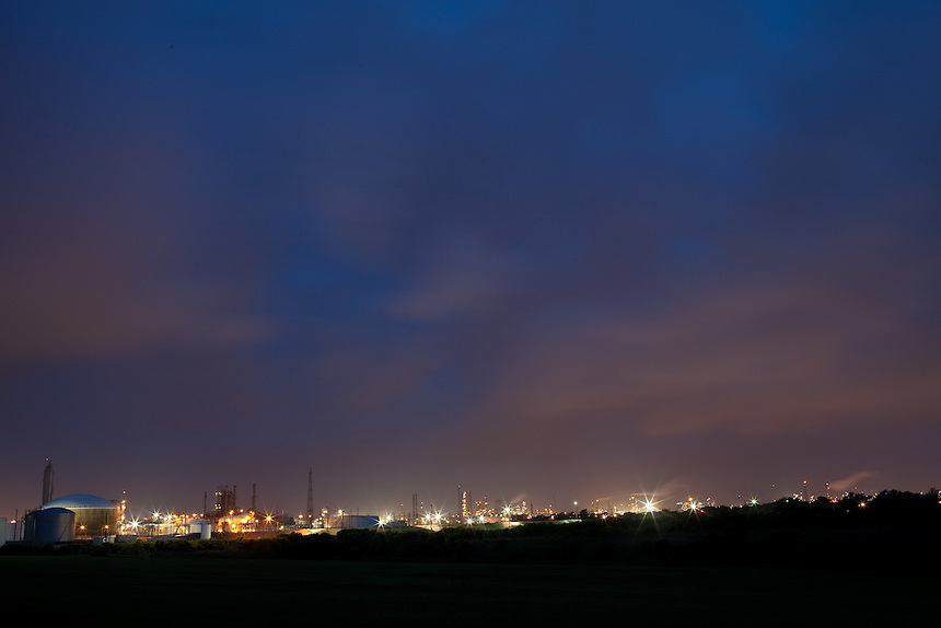 The BP refinery in Texas City, Texas is nearly two squar miles and is one of the largest in the country.  Light from the refinery illuminates the late evening sky.