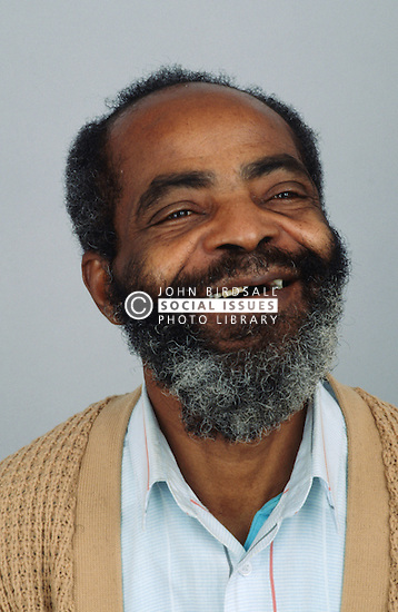 Portrait of elderly man laughing,
