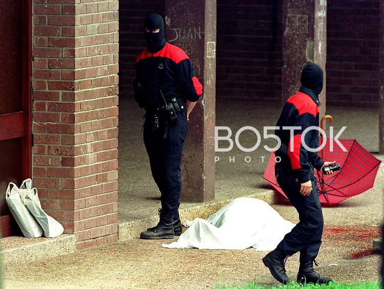 The body of Jose Luis Lopez de la Calle lies under a blanket after being shot by ETA members on May 7th, 2000 in the city of Andoain, Basque Country. (Ander Gillenea / Bostok Photo)