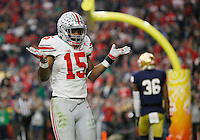 Ohio State Buckeyes running back Ezekiel Elliott (15) celebrates a 47-yard touchdown during the third quarter of the Battlefrog Fiesta Bowl at University of Phoenix Stadium in Glendale, Arizona on Jan. 1, 2016. (Adam Cairns / The Columbus Dispatch)