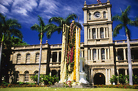 The King Kamehameha Statue draped with colorful flower lei on June 11th, Kamehameha Day, the day that honors him in downtown Honolulu, Hawaii