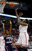 Ohio State Buckeyes center Darryce Moore (22) sinks a basket under pressure from Florida Atlantic Owls guard Aaliyah Dotson (1) in the first half of the college basketball game between the Ohio State Buckeyes and the Florida Atlantic Owls at Value City Arena in Columbus,  Sunday afternoon, November 10, 2013. The Ohio State Buckeyes led the Florida Atlantic Owls 52 - 41. (The Columbus Dispatch / Eamon Queeney)