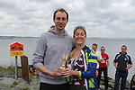 """Sue McKinney presents Oran Kane who came second at the Clogherhead """"Round the Head Swim""""....(Photo credit should read Jenny Matthews/NEWSFILE)..."""