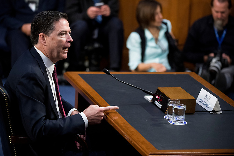 "UNITED STATES - JUNE 8: Former FBI Director James Comey testifies during the Senate Select Intelligence Committee hearing on ""Russian Federation Efforts to Interfere in the 2016 U.S. Elections"" on Thursday, June 8, 2017. (Photo By Bill Clark/CQ Roll Call)"