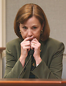 FBI agent Jackie Dalrymple listens to a recording of a phone call she received while working on the sniper task force during her testimony in the trial of sniper suspect John Allen Muhammad in courtroom 10 at the Virginia Beach Circuit Court in Virginia Beach, Virginia on October 31, 2003. <br /> Credit: Adrin Snider - Pool via CNP
