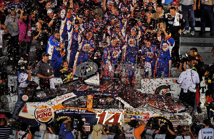 Jul. 4, 2009; Daytona Beach, FL, USA; NASCAR Sprint Cup Series driver Tony Stewart celebrates after winning the Coke Zero 400 at Daytona International Speedway. Mandatory Credit: Mark J. Rebilas-