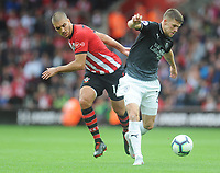 Burnley's Johann Gudmundsson under pressure from Southampton's Oriol Romeu<br /> <br /> Photographer Kevin Barnes/CameraSport<br /> <br /> The Premier League - Southampton v Burnley - Sunday August 12th 2018 - St Mary's Stadium - Southampton<br /> <br /> World Copyright &copy; 2018 CameraSport. All rights reserved. 43 Linden Ave. Countesthorpe. Leicester. England. LE8 5PG - Tel: +44 (0) 116 277 4147 - admin@camerasport.com - www.camerasport.com