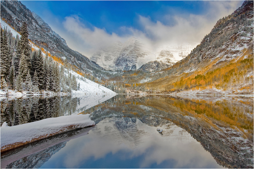To capture this Colorado image in such an iconic setting, I arrived early at the Maroon Bells to a star-filled sky well before sunrise. As the light started to show, so did the clouds. This image of the Bells near Aspen, Colorado, was the last one before the clouds enveloped the regal peaks. The snows soon returned that morning at Colorado's most photographed mountain peak.