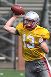 Connor Halliday (#13), Washington State freshman quarterback, uncorks a pass during the Cougars fall camp workout at Rogers Practice Field on the WSU campus in Pullman, Washington, on August 11, 2010.