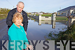 FLOODS: Pascal Hurley and Diane Kennedy, residents of Ardrahan, Ardfert at the scene of significant flooding outside their homes which has persisted for several weeks.