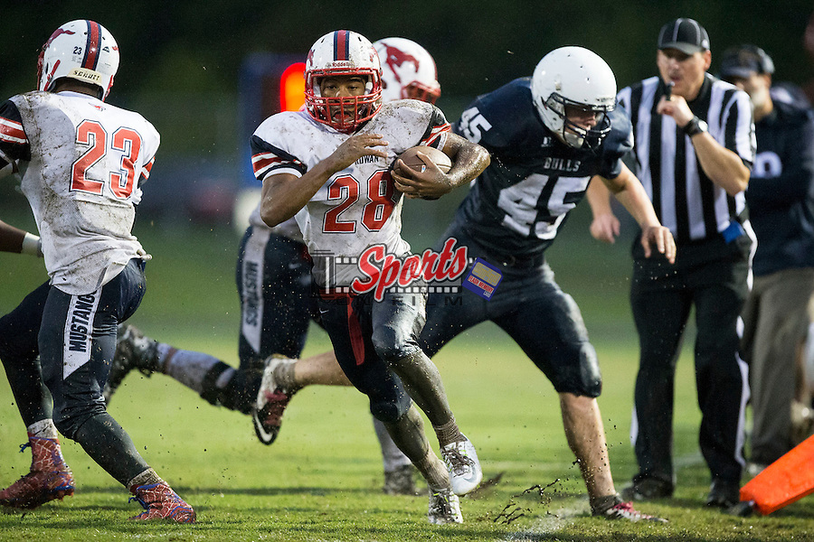 Keith Tillman (28) of the East Rowan Mustangs runs down the sideline during first half action against the Hickory Ridge Ragin' Bulls at Hickory Ridge High School on October 2, 2015 in Harrisburg, North Carolina.  The Ragin' Bulls defeated the Mustangs 20-7.  (Brian Westerholt/Sports On Film)