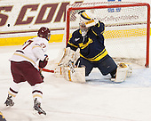 Quinn Smith (BC - 27), Rasmus Tirronen (Merrimack - 32) - The Boston College Eagles defeated the visiting Merrimack College Warriors 2-1 on Wednesday, January 21, 2015, at Kelley Rink in Conte Forum in Chestnut Hill, Massachusetts.