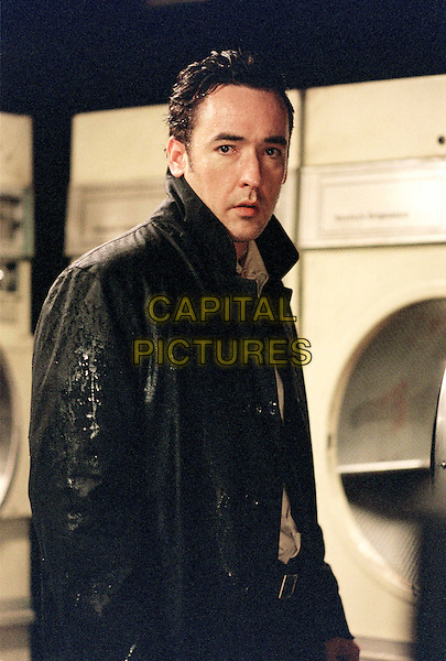 IDENTITY.John Cusack plays Ed, a cynical limo driver who is stranded at a roadside motel during a rain storm in Columbia PicturesÍ psychological suspense thriller Identity. .Filmstill - Editorial Use Only.Ref: FB.sales@capitalpictures.com.www.capitalpictures.com.Supplied by Capital Pictures.
