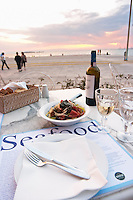 Dinner at a waterfront restaurant. Seafood restaurant at Macedonia Palace Hotel. Thessaloniki, Macedonia, Greece