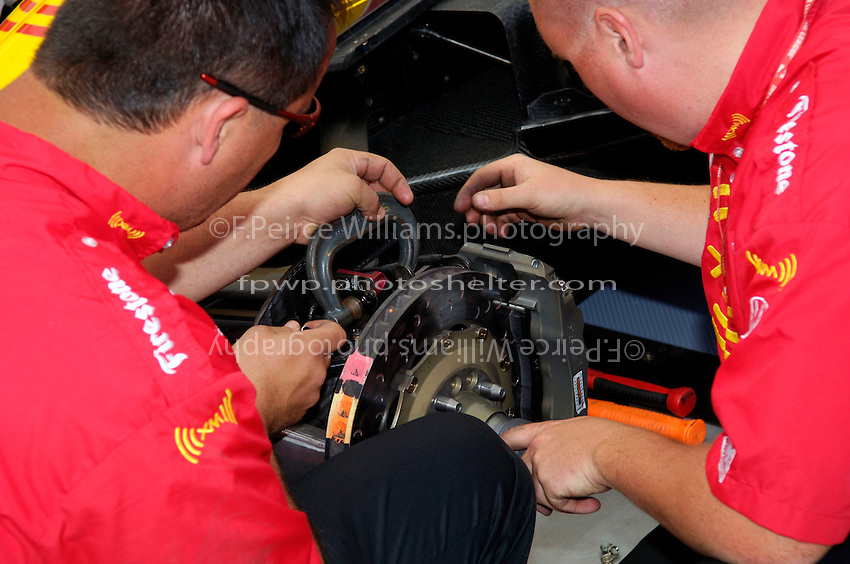 Grand Prix of St. Petersburg, 3 April, 2005.Setting up the brakes on Bryan Herta's car..Copyright©F.Peirce Williams 2005.  ref.Digital Image Only