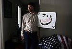 Adam Warshauer, 37, from Delray Beach, FL, whose father is Jewish and mother is a Christian, became a Sufi Muslim after being introduced to the faith by a man he met at 22. He is seen here posing for a portrait with a passage from the Surat Al-Qalam in the Koran, in a just-moved-into office space in Delray Beach, on March 12, 2016. <br /> <br /> He credits his background for being able to see connections between the three religions, and plans to start a YouTube show directly addressed to U.S. Presidential candidate Donald Trump (R-NY,) with the aim of creating &ldquo;peace between the Israel and Arab nations.&rdquo; It would feature a hand puppet called Uncle Musa - a relative to Moses, a prophet who appears in the Torah, Bible and Koran.<br /> <br /> Politically, he says he identifies most as an Independent: &ldquo;I believe in protecting the environment, and Republicans don&rsquo;t, which is why I am not Republican.&rdquo; Warshauer plans to support Trump, however, especially if he wins Tuesday&rsquo;s primary elections and goes on to become the Republican nominee for president. <br /> <br /> Warshauer says he does not believe Trump wants to ban Muslims from entering the country because of a dislike for them, but because he wants to solve terrorism.&nbsp;&ldquo;Most are outraged at Trump saying he wants to ban Muslims from entering America, but I support that as a Muslim person, because we have to stop what is happening and work with other Muslim countries to stop terrorism. If you stop Muslims from entering the country, it forces everyone to look at the problem.&rdquo; He adds that &ldquo;Isis killings are ruining the face of Islam. Who wants to become Muslim when it is associated with terrorism?&rdquo;<br /> <br /> &ldquo;People pull stuff they want to go &ldquo;Oh, my God!&rdquo; about, but come on, forget about that and just focus on what's real,&rdquo; which Warshauer says is Trump&rsquo;s job creation capability and his focus on stopping the drug epidemic in