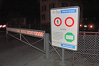 Closing secondary road at night, by at patrol of the Swiss Corps of Gardes Frontière, on the border between Switzerland and France in Geneva province..Swiss traffic signs forbidding human crossing, except during the day with international identity document and with less then customs tolerate goods.