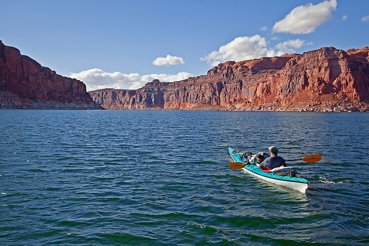Jacque Miniuk paddles out of Good Hope Bay on Lake Powell in the Glen Canyon National Recreation Area, Utah