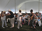 The audience dances during the performance by Chico Alvarez with the Palomonte Afro-Cuban Big Band, at the Annual Jazz in the Valley Festival,  in Waryas Park in Poughkeepsie, NY, on Sunday, August 21, 2016. Photo by Jim Peppler. Copyright Jim Peppler 2016 all rights reserved.