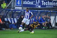 VOETBAL: HEERENVEEN: ABE LENSTRA STADION: 19-10-2013, SC Heerenveen - Vitesse uitslag 2-3, overtreding van Vitesse speler Ronato Ibarra(#30) op Rajiv van La Parra (#7), ©foto Martin de Jong