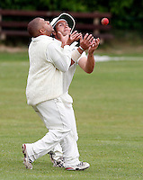 S Levi (L) and Brandon Buckley appear to collide but it's S Levi who takes the catch to dismiss a Finchley batsman during the Middlesex County Cricket Premier League game between Hampstead and Finchley at Lymington Road, Hampstead on Sat July 18, 2009
