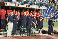 The USA bench stands for the national anthem before the United States played Guatemala at Estadio Mateo Flores in Guatemala City, Guatemala in a World Cup Qualifier on Tue. June 12, 2012.