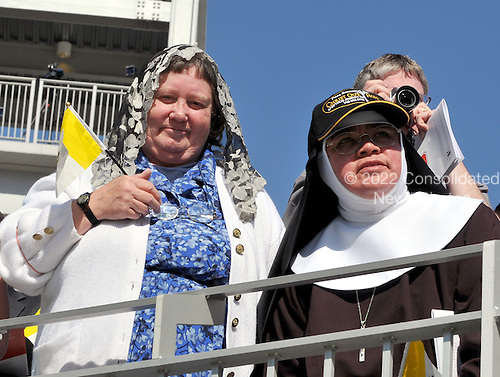 Washington, DC - April 17, 2008 -- Unidentified women look on as Pope Benedict XVI celebrates Mass at the new Nationals Park in Washington, D.C. on Thursday, April 17, 2008. This is the first non-baseball event in the park, which opened March 31..Credit: Ron Sachs / CNP.(RESTRICTION: NO New York or New Jersey Newspapers or newspapers within a 75 mile radius of New York City)
