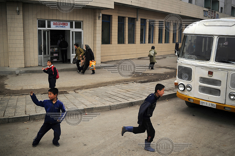 Children playing in the road in central Pyongyang....