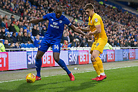 Sol Bamba of Cardiff City protects the ball from Jordan Hugill of Preston North End during the Sky Bet Championship match between Cardiff City and Preston North End at the Cardiff City Stadium, Cardiff, Wales on 29 December 2017. Photo by Mark  Hawkins / PRiME Media Images.