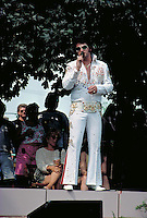 Elvis impersonator age 30 performing for crowd at Grand Old Day.  St Paul  Minnesota USA