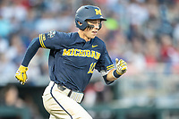 Michigan Wolverines third baseman Blake Nelson (10) runs to first base against the Vanderbilt Commodores during Game 3 of the NCAA College World Series Finals on June 26, 2019 at TD Ameritrade Park in Omaha, Nebraska. Vanderbilt defeated Michigan 8-2 to win the National Championship. (Andrew Woolley/Four Seam Images)