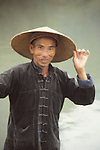 China, a boatman on the Li River in Guangxi Zhuang Autonomous Region