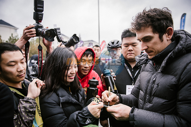 Tour de France Champion Geraint Thomas (WAL) Team Sky signs autographs for fans before the 2018 Shanghai Criterium, Shanghai, China. 16th November 2018.<br /> Picture: ASO/Pauline Ballet | Cyclefile<br /> <br /> <br /> All photos usage must carry mandatory copyright credit (© Cyclefile | ASO/Pauline Ballet)