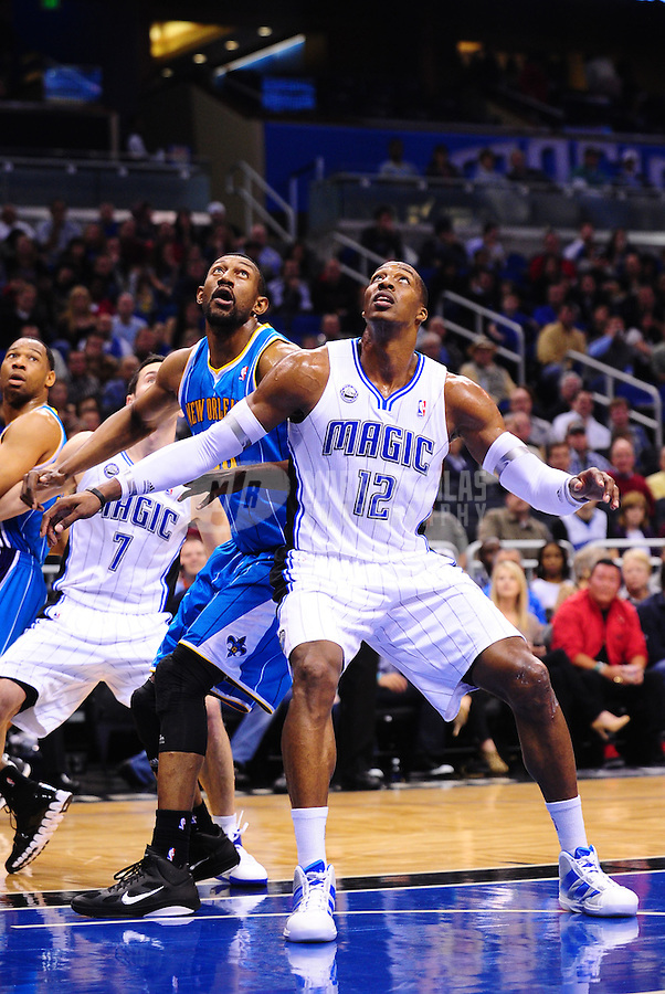 Feb. 11, 2011; Orlando, FL, USA; Orlando Magic center Dwight Howard (12) and New Orleans Hornets center Didier Ilunga-Mbenga position for a rebound at the Amway Center. The Hornets defeated the Magic 99-93. Mandatory Credit: Mark J. Rebilas-USA TODAY Sports
