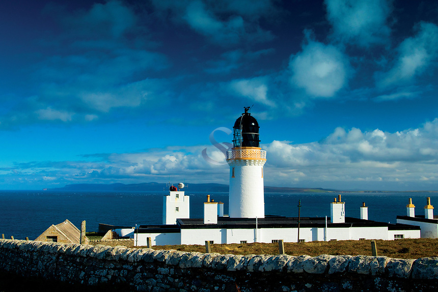 Dunnet Head Lighthouse, the Orkney Island of Hoy and The Pentland Firth from Dunnet Head, mainland Britain's northernmost point, Caithness