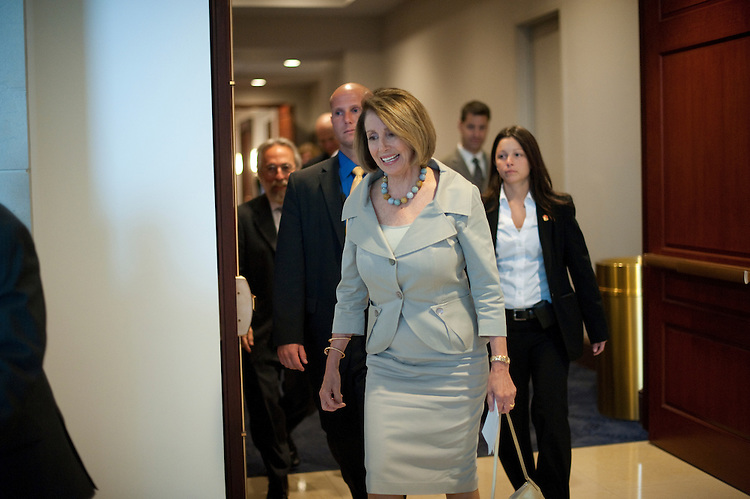 UNITED STATES - JULY 28: Minority Leader Nancy Pelosi, D-Ca., leaves the House Democratic Caucus on party matters in the basement of the U.S Capitol's Visitors Center on July 28, 2011. (Photo By Douglas Graham/Roll Call)