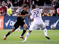 DC United forward Josh Wolff (16) goes against Los Angeles Galaxy defender Leonardo (22)   DC United tied  Los Angeles Galaxy 1-1, at RFK Stadium, Saturday April 9, 2011.