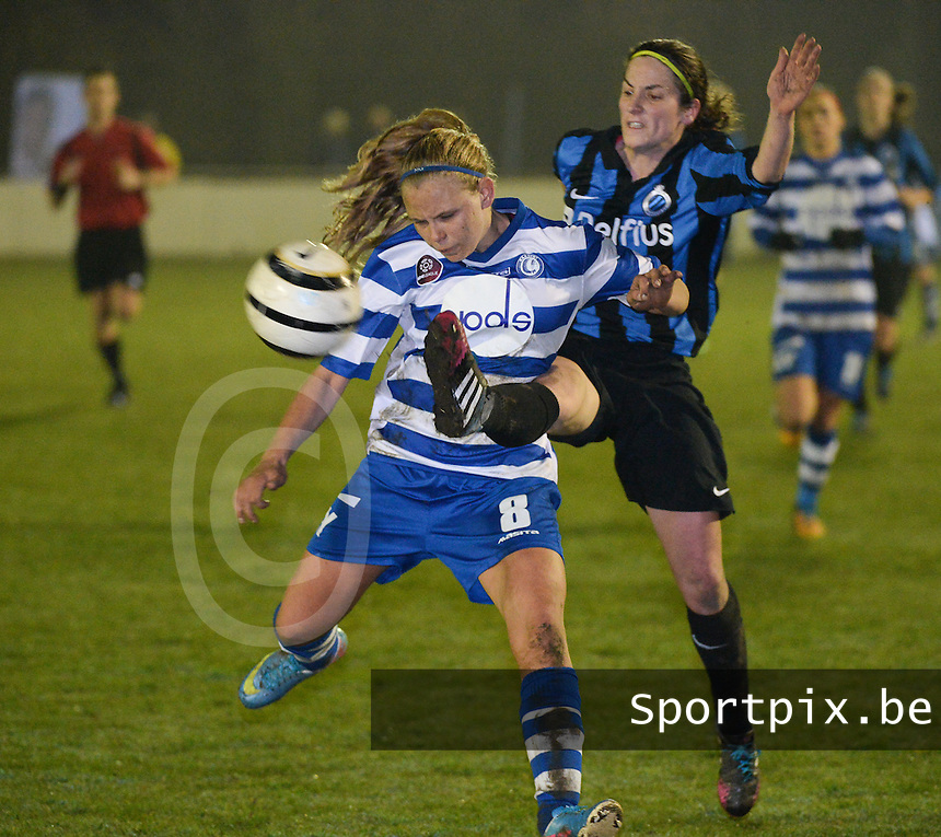 20140326 - AALTER , BELGIUM : duel pictured between Brugge's Lore Dezeure (r) and Gent's Marijke Philips (l) during the soccer match between the women teams of Club Brugge Vrouwen  and AA Gent  Ladies , on the 21th matchday of the BeNeleague competition Friday 14 March 2014 in Aalter. PHOTO DAVID CATRY