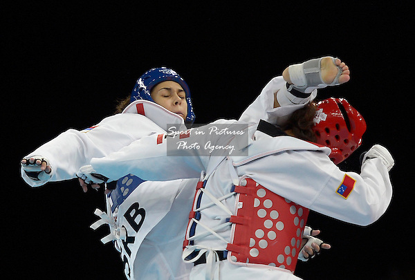 Malica Mandic (SRB, Serbia, blue) and Talitiqa Crawley (SAM, Samoa). taekwondo - PHOTO: Mandatory by-line: Garry Bowden/SIP/Pinnacle - Photo Agency UK Tel: +44(0)1363 881025 - Mobile:0797 1270 681 - VAT Reg No: 768 6958 48 - 10/08/2012 - 2012 Olympics - Aquatics Centre, Olympic Park, London, England
