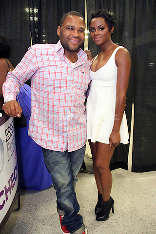 NEW ORLEANS, LA - JULY 4: Tika Sumpter & Anthony Anderson backstage at the 20th Anniversary of the Essence Festival at the Mercedes Benz Superdome, July 4, 2014 in New orleans, Louisiana. Credit: Walik Goshorn/MediaPunch